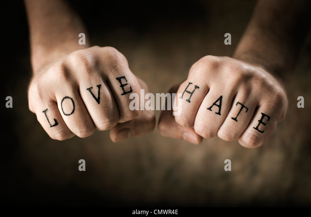 Man with (fake) Love and Hate tattoos on his hands. - Stock Image