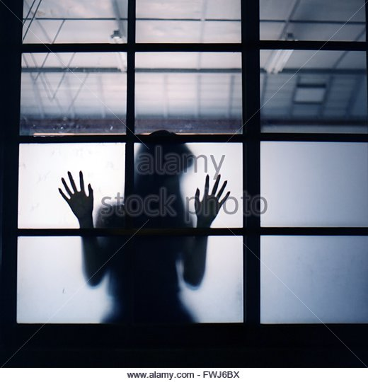 Silhouette Woman Against The Window - Stock Image