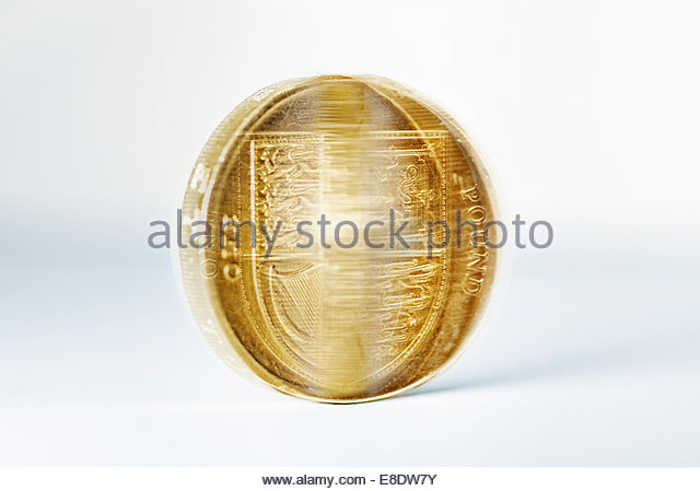 Spinning British one pound coin sterling - Stock Image