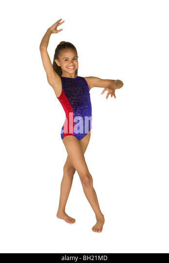8 year old African-American girl in gymnastics poses - Stock Image