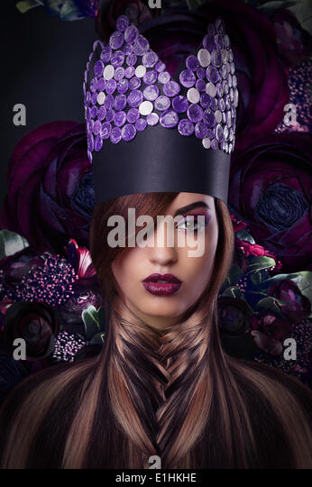 Imagination. Extravagance. Styled Woman in Fantastic Headwear - Stock Image