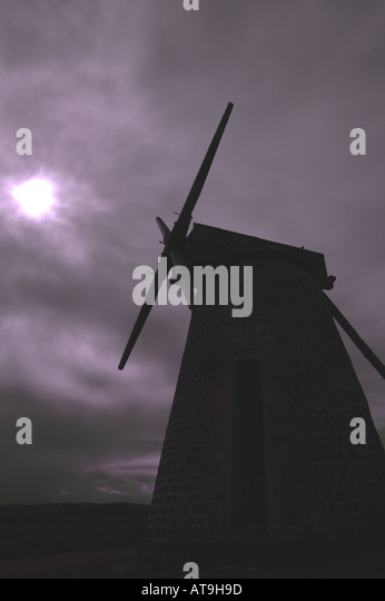Antigua Betty s Hope windmill tower haunting silhouette full moon cloudy sky - Stock Image
