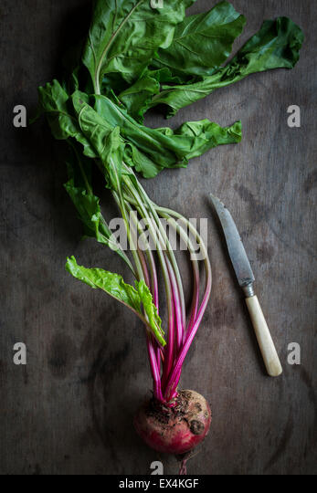 Beetroot on wooden background with knife. Top view - Stock Image