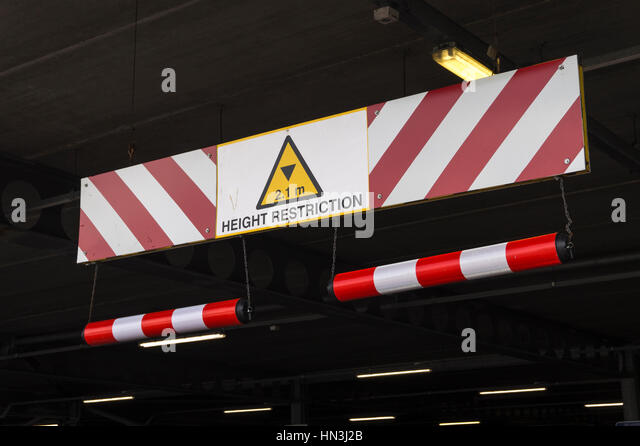 Height Restriction Sign in Underground Car Park - Stock Image