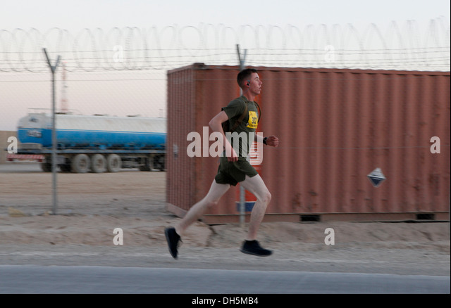 Runners compete in the 2013 Marine Corps Marathon Fowrard at Camp Leatherneck, Afghanistan Oct. 27. More than 300 - Stock Image
