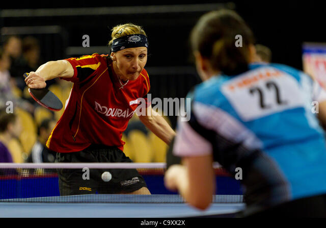 EINDHOVEN, THE NETHERLANDS, 03/03/2012. Table tennis player Yana Timina (left) wins her match at the Dutch table - Stock Image
