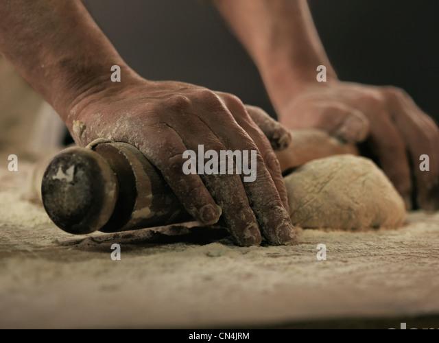 Baker rolling dough - Stock-Bilder