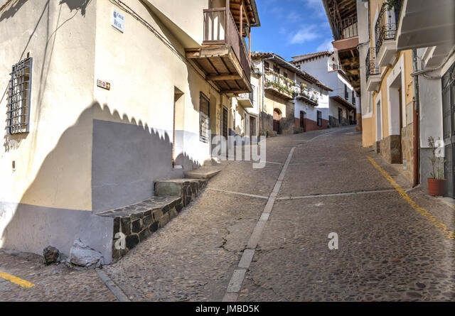 Guadalupe old town steep street, Caceres, Extremadura, Spain - Stock Image