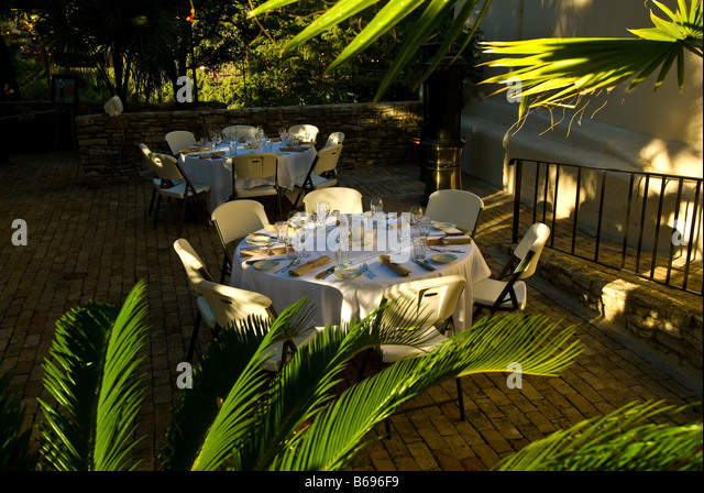 La Villita historic arts village san Antonio texas tx dining open air restaurant table surrounded green plants  - Stock Image