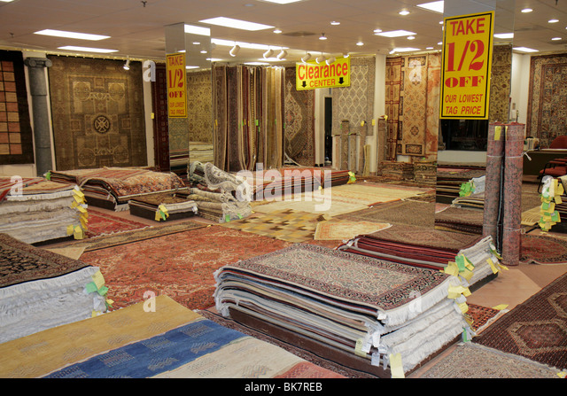 Virginia Alexandria Old Town Alexandria King Street store business Oriental rugs sale clearance half price stack - Stock Image