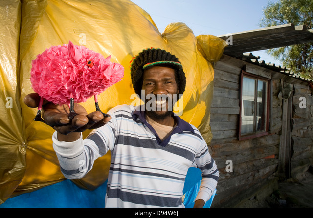 Henry Naki with his recycled plastic pink pig products - Born in Queenstown, Eastern Cape - Stock Image