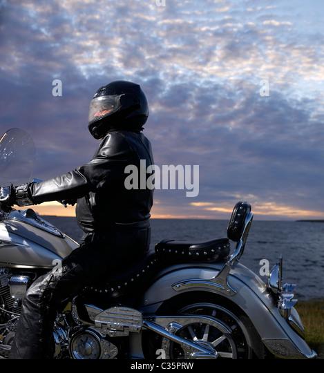 Biker by the sea, Reykjavik Iceland - Stock Image