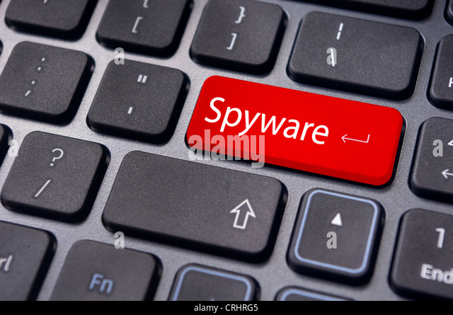 spyware concepts, with message on enter key of keyboard. - Stock Image