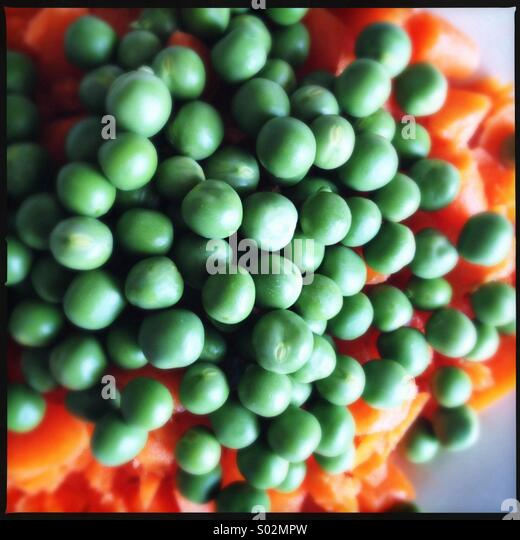 Fresh Peas and Carrots - Stock Image