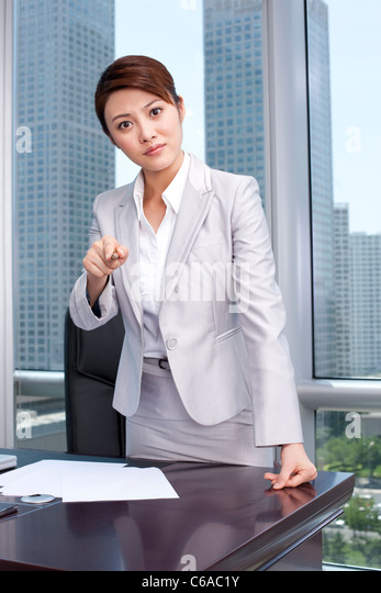 Portrait of an upset businesswoman - Stock Image