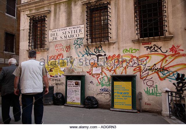 Graffiti ruins the view in a small square near Saint Marks Square; Venice Italy - Stock Image