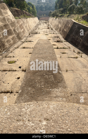 Concrete rundown overflow spillway in an old dam - Stock Image