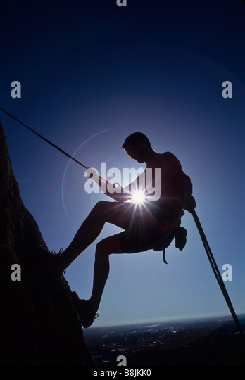 Silhouette of rock climber - Stock Image
