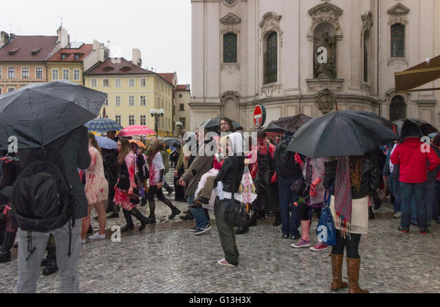 Zombie walk - Prague, Czech Republic - young woman holding a young girl in the rain - Stock Image