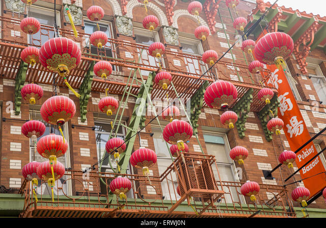 Lanterns hanging outside building on Grant Street in Chinatown, San Francisco, California, USA - Stock Image