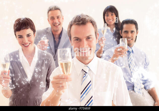Composite image of international business people toasting with champagne - Stock-Bilder