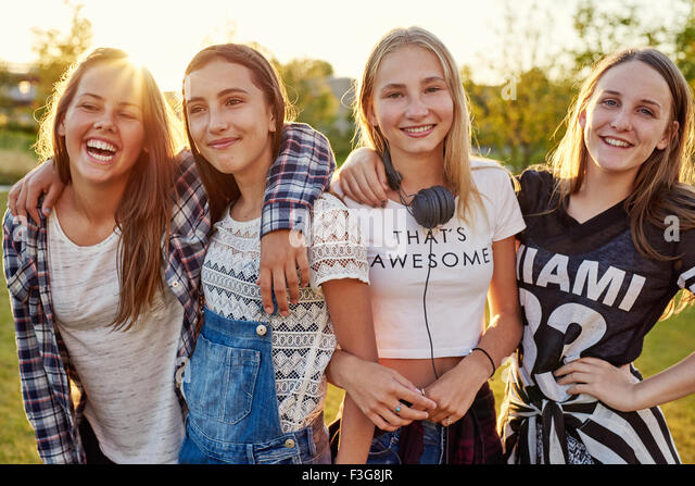 Group of teenage girls hanging out on a summer evening - Stock Image