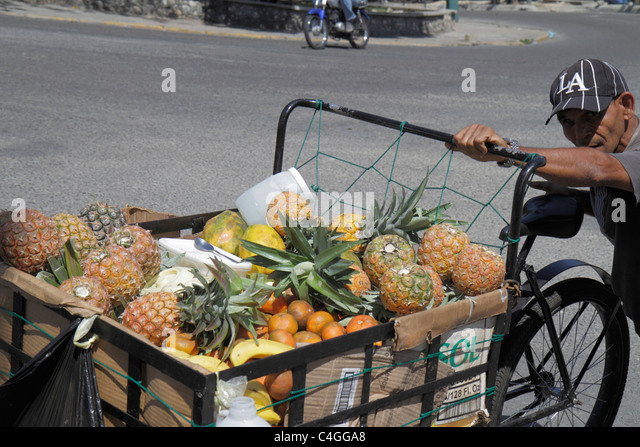 Santo Domingo Dominican Republic Ciudad Colonia Calle Juan Alba street vendor produce fruit cart pineapple orange - Stock Image