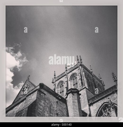 Light shining on church roof, Sherborne, England - Stock Image