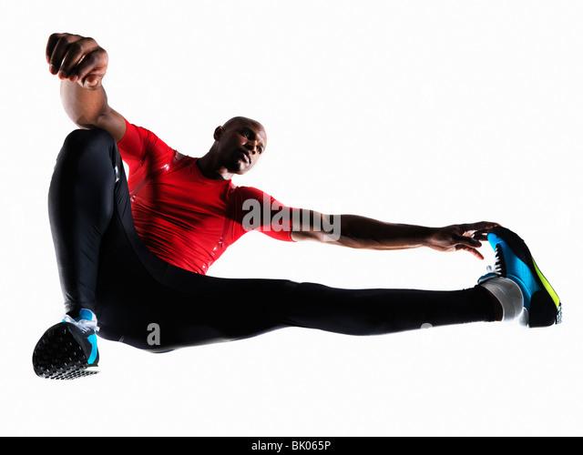 Male athlete stretching - Stock Image