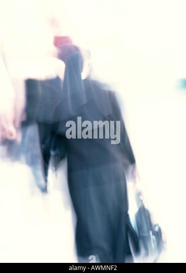 Nun, rear view, blurred - Stock-Bilder
