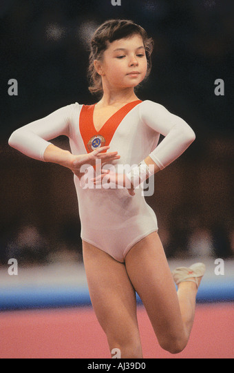 Young Russian woman gymnast competing in Floorwork section of a competition - Stock Image