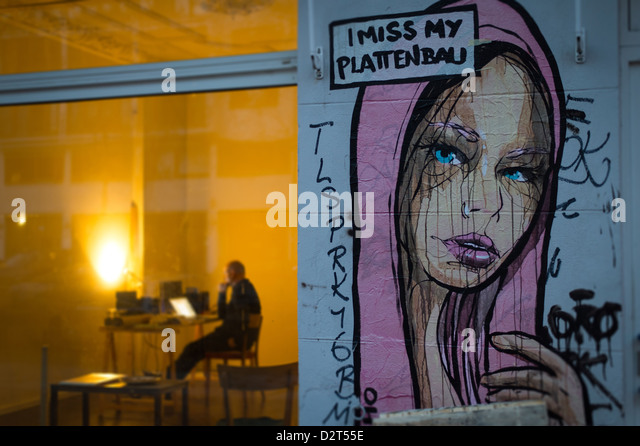 Berlin, Germany, the man sitting in front of a computer in a business in the Senefelderstrasse - Stock Image