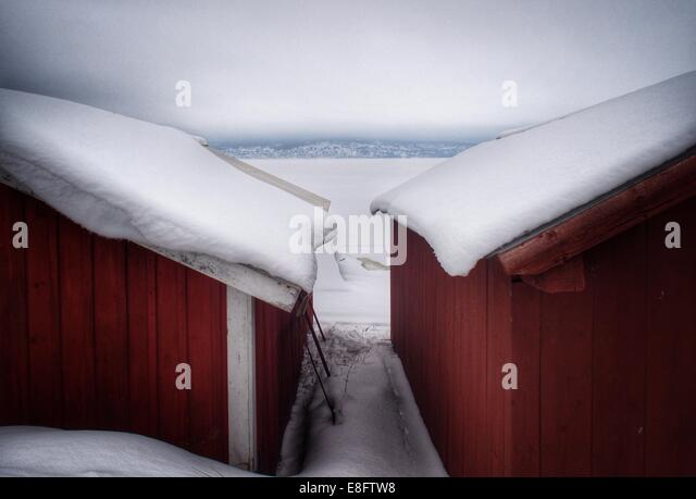 Sweden, Snow covered buildings - Stock-Bilder