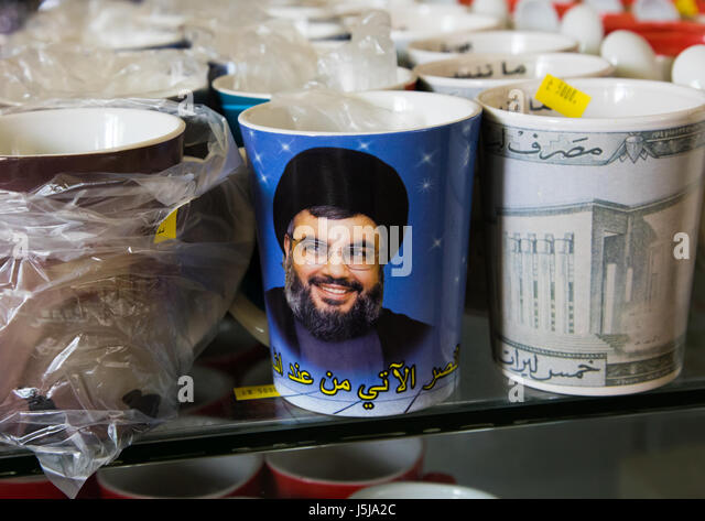 Sheikh Hassan Nasrallah mug in the hezbollah souvenirs shop in the tourist landmark of the resistance, South Governorate, - Stock-Bilder