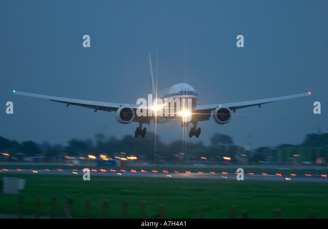 American Airlines Boeing 777 200 late evening arrival at London Heathrow Airport UK - Stock Image