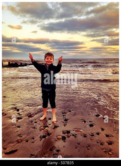Big sky, big beach, small boy. Hornsea. - Stock Image