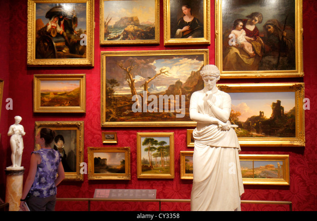 Massachusetts Boston Huntington Avenue Museum of Fine Arts collection paintings art woman viewing sculpture - Stock Image