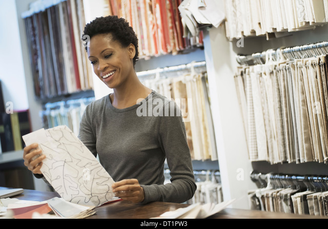 Woman working in design shop - Stock Image