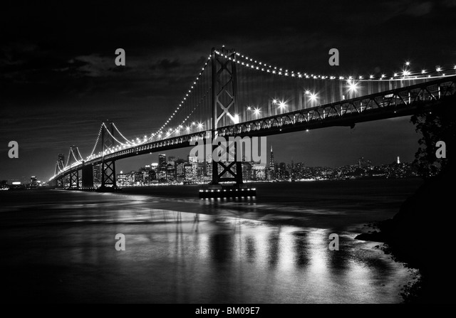 View of San Francisco and the Oakland Bay Bridge at night - Stock Image