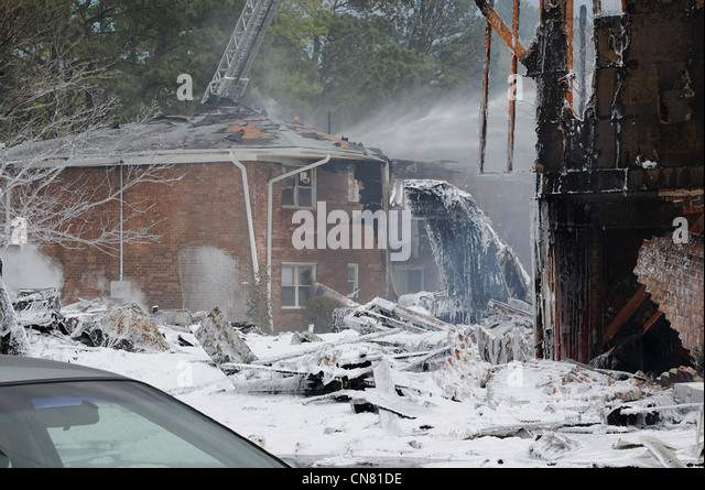 Firefighting foam covers the scene of a crash where a US Navy F-18 aircraft crashed after taking off from Naval - Stock Image
