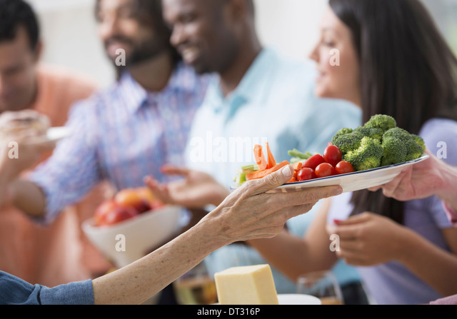 A picnic party of family adults and children - Stock Image