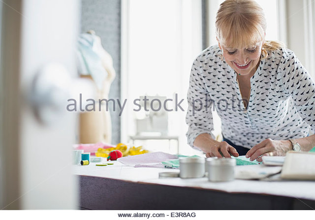 Seamstress working with pattern - Stock Image