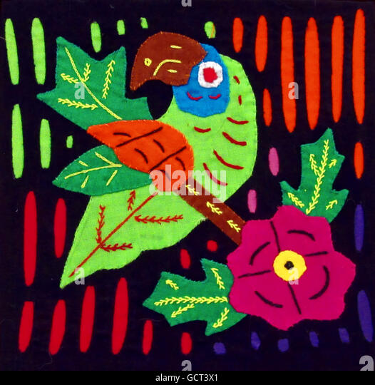 Traditional Panamanian colorful fabric artwork created by the Kuna indigenous people consisting of fabric panels - Stock Image