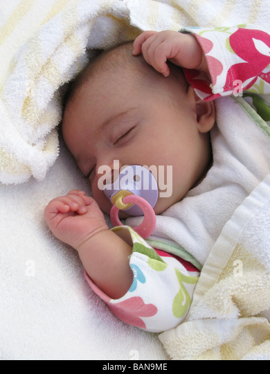 A sleeping baby - Stock Image