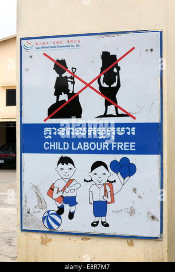 Sign against child employment on a gate of a textile factory in the industrial area Pochentong, Phnom Penh, Cambodia, - Stock Image