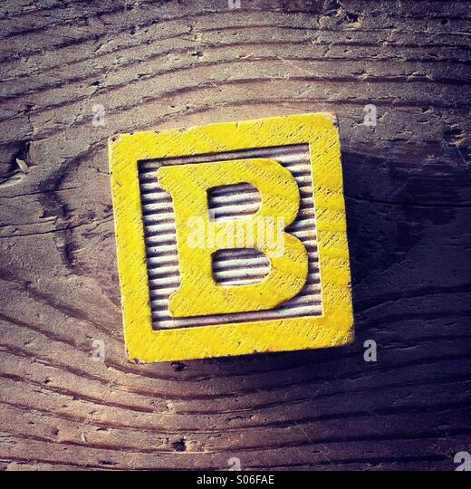 It's a woodblock toy with an alphabet letter on it: B - Stock Image