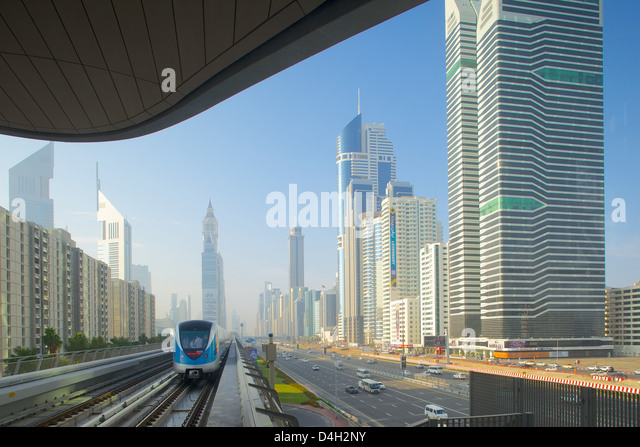 Metro and skyscrapers on Sheikh Zayed Road, Dubai, United Arab Emirates, Middle East - Stock Image