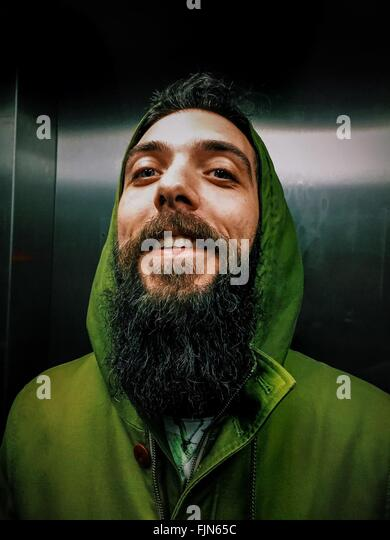 Young Cheerful Man With Long Beard In Elevator - Stock-Bilder