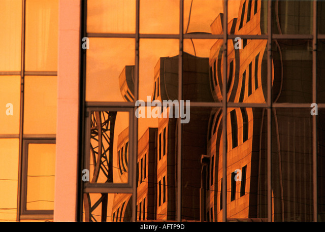 Reflections of modern office reflected in glass and steel building City of London - Stock Image