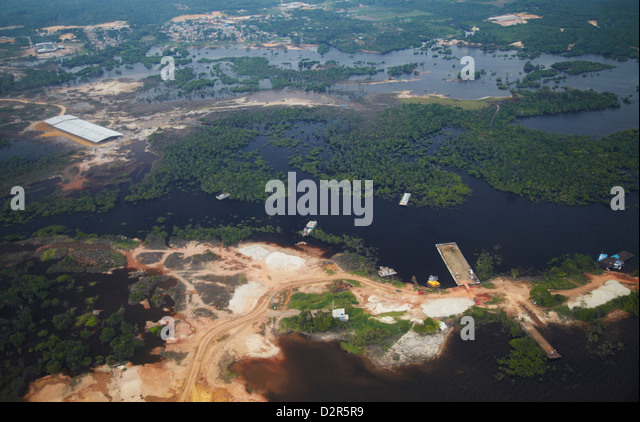 Aerial view of Amazon rainforest cleared for industry along the Rio Negro, Manaus, Amazonas, Brazil, South America - Stock Image